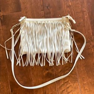Cream colored fringe cross body bag